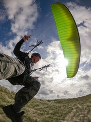 Paraglider pilot close up soaring in Netherlands at sunny day