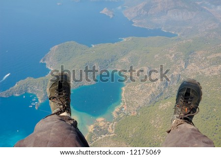Paraglider's look at the earth below his feet