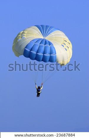 Paraglider Soaring in Blue Sky