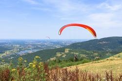 Paragliders start their flight on Zar mountain near Zywiec in southern Poland
