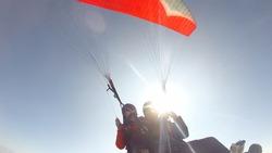 Paragliding against sunshine
