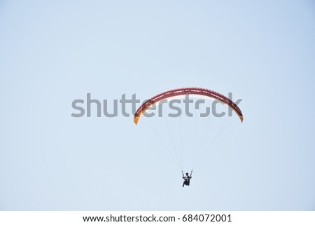 Paragliding experience means freedom and leave the fears behind #684072001
