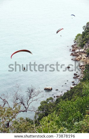 Paragliding extreme sports activities along the scenic Straits of Malacca of a cliff at Tanjung Tuan wildlife conservation sanctuary park in Cape Rachado, Malaysia