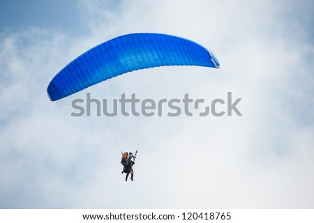 Paragliding in cloudy day
