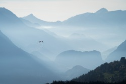 Paragliding in Interlaken / Switzerland offers a breathtaking view over the Swiss Alps.