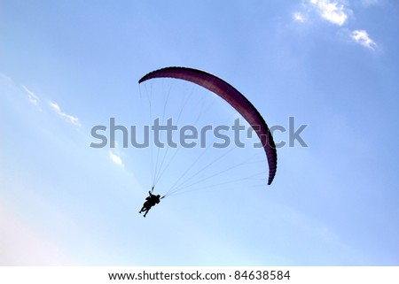 Paragliding in Ukraine over the sea against blue sky