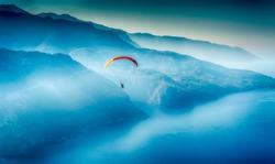 Paragliding over Babadag mountain. Oludeniz Turkey. Blue mountains.