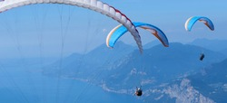 Paragliding over Lake Garda (Lago di Garda or Lago Benaco) from Monte Baldo mountain, Italy