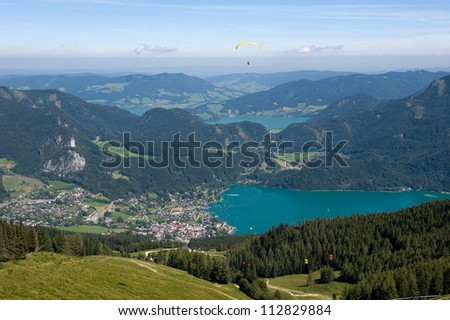 Paragliding over the alps near the town of st.Gilgen at the Wolfgangsee in Austria