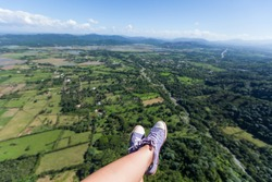paragliding, snickers shoes, enjoyment, outdoors, mountains, aerial, risk, action, rock, glider, flight, gliding, leisure, adrenaline, high, fly, active, activity, air, extreme, parachute, legs, hill,