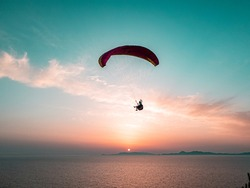 Paragliding with amazing sunset view