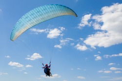 paragliding with beautiful scenery, flying with a wing of a parachute