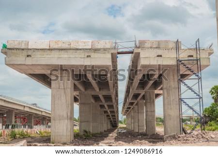Parallel bridge way under contruction,countryside,long bridge,tollway,The road outside,Site construction of the bridge tollway large.