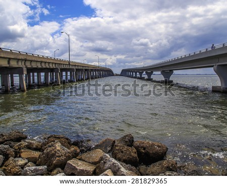 stock-photo-parallel-bridges-span-tampa-bay-one-bridge-is-for-foot-traffic-the-other-is-for-vehicle-traffic-281829365.jpg