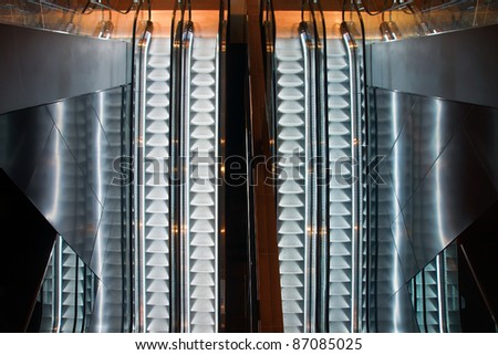 Parallel escalators and reflections seen from above