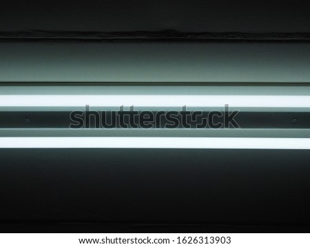 parallel of fluorescent lights background