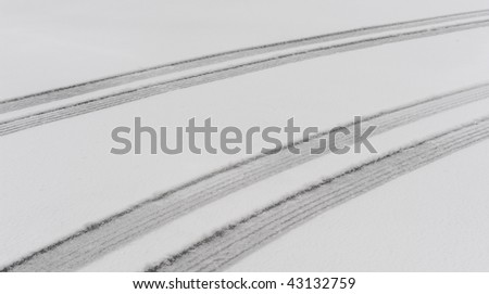 Parallel tire tread tracks in the snow