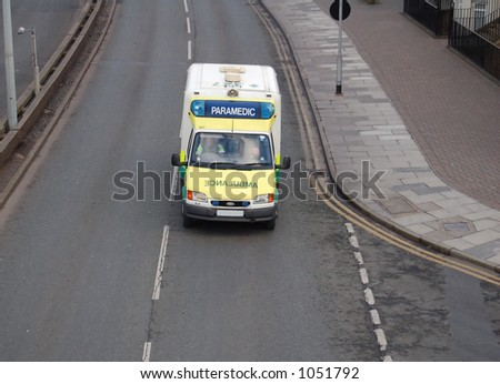 Paramedic ambulance on the way to an emergency with blue lights on