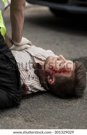 Paramedic applying first aid victim of car crash