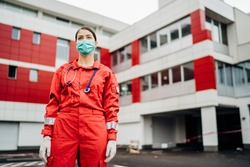 Paramedic in front of isolation hospital facility.Coronavirus Covid-19 heroes.Mental strength of medical professional.Emergency room doctor prepared for virus outbreak.Ready for hard work.Brave nurse
