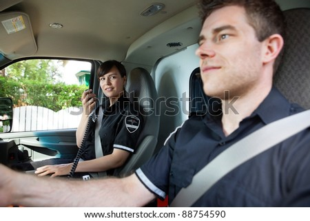 Paramedic team in an ambulance interior driving to destination