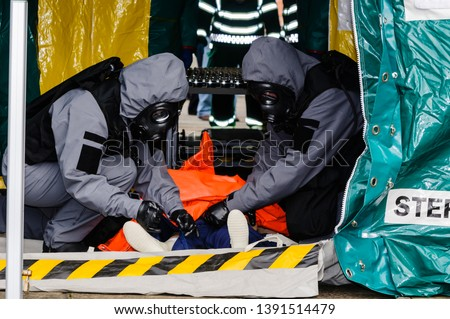 Paramedics demonstrate the decontamination procedure during the launch of Northern Ireland Ambulance Service (NIAS) Hazardous Area Response Team (HART).