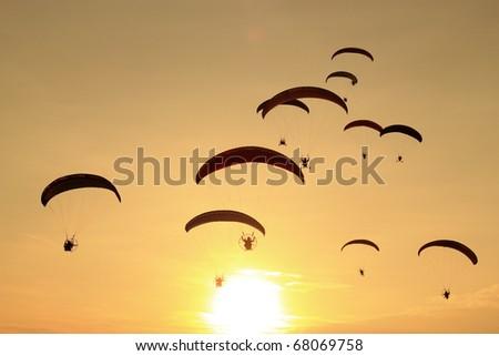 paramotor in sunset