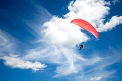 Paraplane in the blue sky.