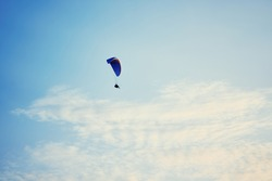 Paraplane on the blue sky background, leisure activity.