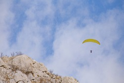 Paraplaner in the sky, cloudy sky background