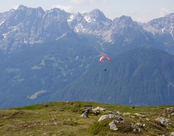 paraplanes fly on the background of mountains and sky. Summer background with mountains