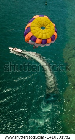 Parasailing activity with boat and sea background  #1410301982