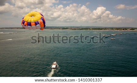 Parasailing activity with boat sky and sea background  #1410301337