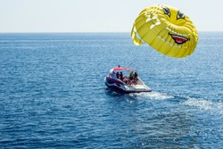 Parasailing, boat parachute. Summer water beach extreme sports.