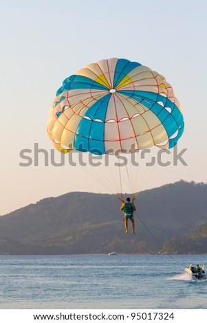 Parasailing in the eveing, taken in Phuket Patong Beach, Thailand