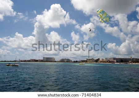 parasailing in the ocean off of Cancun Mexico