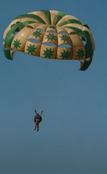 Parasailing on a big round parachute on a Holiday