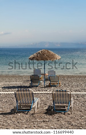 Parasol and chairs on the beach, Greece, Santorini