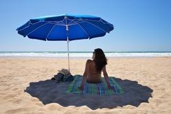 parasol at Conil Beach in Cadiz Andalusia Spain