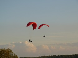 Paratroopers hover in the sky