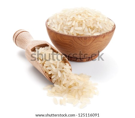 parboiled rice in a wooden bowl isolated on white background - stock photo
