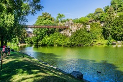 Parc des Buttes-Chaumont - Public Park situated in northeastern Paris. It was opened in 1867; it is fifth-largest park in Paris. 63-meter-long suspension bridge, designed by Gustave Eiffel in 1867.