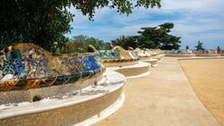 Parc Guell, square with benches made in unusual architectural style in Barcelona, Spain