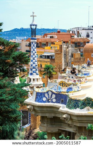 Parc Guell, visitors on a viewpoint with unusual architectural style, cityscape of Barcelona on the background, Spain Photo stock ©