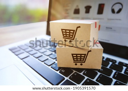 Parcel box on a laptop with Shopping service on the online website,E-commerce or online shopping concept.