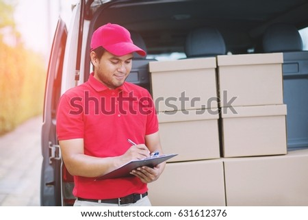 parcel delivery man Smiling  postal delivery Impressive service.Check stock Prepare to send the package to the customer.