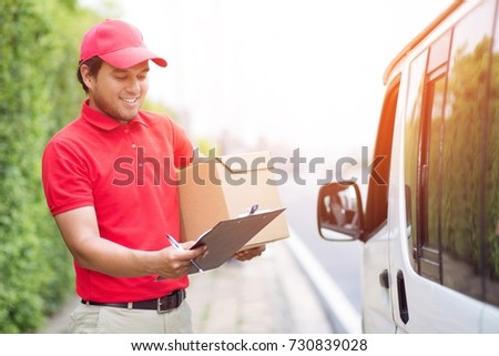 parcel delivery man stand beside van counting Check stock Prepare to send the package to the customer. Validate every time in transportation. In order not to make mistakes in the work.