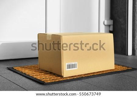 Parcel in cardboard box left on door step (it\'s not real QR code)