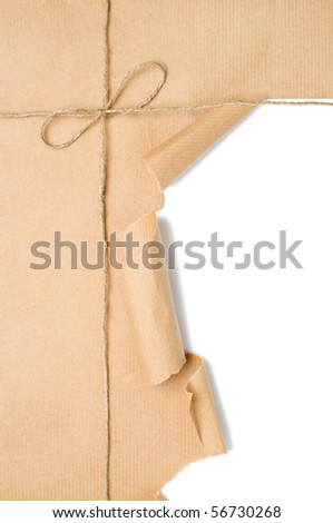 Parcel tied with string with corner open to reveal white copy space