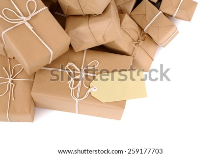 Parcel : Untidy pile of brown package, label, isolated